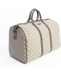 Gucci Beige Gg Supreme Canvas Carry-On Duffel Bag - Lyst