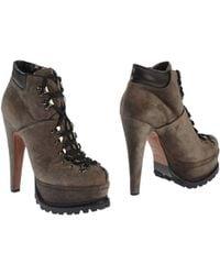 Alaïa Gray Ankle Boots - Lyst