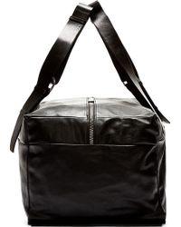 Ann Demeulemeester - Black Leather Duffle Bag - Lyst