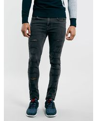 Topman Washed Black Shredded Spray On Skinny Jeans - Lyst