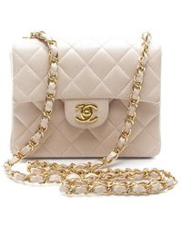 Chanel Preowned Beige Lambskin Mini Flap Bag - Lyst