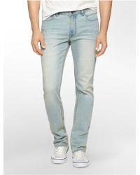 Calvin Klein Jeans Slim Straight Leg Faded Aqua Wash Jeans blue - Lyst