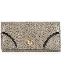 Vivienne Westwood Frilly Snake Long Flap Wallet beige - Lyst