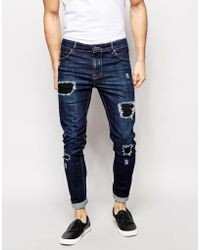 Asos Super Skinny Jeans With Rips - Lyst