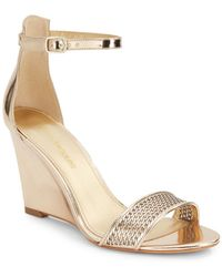 Enzo Angiolini Raledy Perforated Metallic Wedge Sandal - Lyst