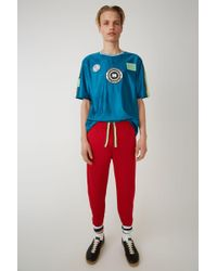 Acne Studios - Track Trousers red/green - Lyst