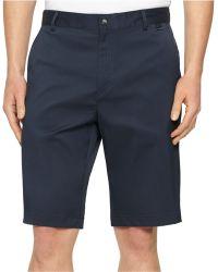 Calvin Klein Core Flat-Front Stretch Shorts blue - Lyst