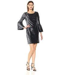 dd0d3c6d8ea Lyst - Nicole Miller Two Tone Ruffle Bell Sleeve Sheath Dress in Black