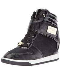 7fcce6507bb Bebe Sport Charlane Wedge Sneakers in Black - Lyst