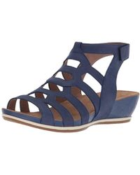 17c49099f103 Lyst - Dansko Valentina Leather Gladiator Wedge Sandals in Metallic
