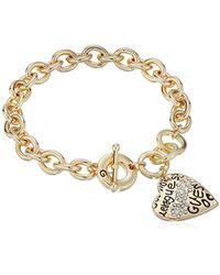 "Guess - ""basic Graffiti Logo Heart Toggle Charm Bracelet - Lyst"