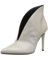 ca61af887f11 Lyst - Guess Adazzle Satin Lace-up Booties