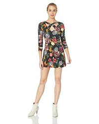 7c76b2f8abc7 Lyst - Guess Long Sleeve Beverly Surplice Romper