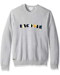 fb30ea4b85bd0a Lacoste - Long Sleeve Letter Block Graphic Sweater (flour multico) Men s  Sweater -