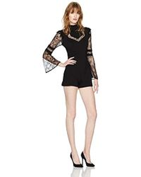 601a2a1e9fb9 Lyst - Charlotte Russe Lace Combo Bell Sleeve Romper in Black