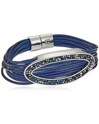 Kenneth Cole - Shiny Silver Items Corded With Oval Blue Tonal Sprinkle Stone Bracelet - Lyst