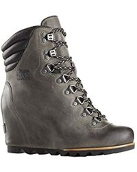 ae1eb93356bf Lyst - Sorel Leather Conquest Wedge Holiday Boots in Brown