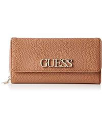 Guess - Uptown Chic Slg Lrg Cltch Org Wristlet - Lyst