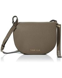 Calvin Klein - Neat Medium Saddle Bag Cross-body Bag - Lyst