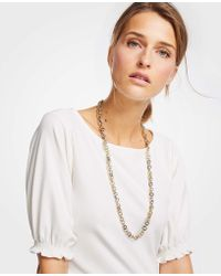 Ann Taylor - Mixed Metallic Ring Necklace - Lyst