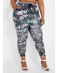 ce1d8bccdab Ashley Stewart - Plus Size Newspaper Graffiti Active Jogger - Lyst