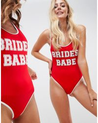 ASOS - Design Brides Babe Slogan Swimsuit With Contrast Bind In Red - Lyst