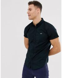 Hollister Icon Logo Short Sleeve Oxford Shirt Slim Fit Button Down In Black