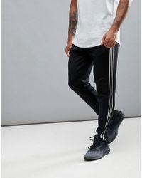 adidas - Joggers neri in maglia cg2129 - Lyst