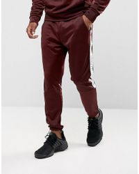 Illusive London - Skinny Track Joggers In Burgundy With Taping - Lyst