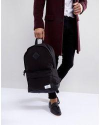 709f242ae772a ASOS - Rucksack aus schwarzem Leinen mit Kunstlederboden - Lyst