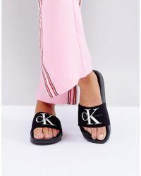 CALVIN KLEIN 205W39NYC - Jeans Chantal Black Slider Flat Sandals - Lyst