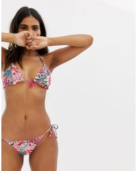 810974b86ac2 In saldo Accessorize - Slip bikini double-face a fiori vivaci con laccetti  laterali - Lyst
