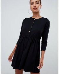 e0880dd14a9 PrettyLittleThing - Button Through Skater Dress In Black - Lyst