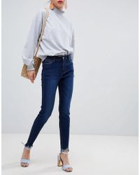 Urban Bliss - Distressed Ripped Skinny Jean In Indigo Wash With Destroyed Hem - Lyst