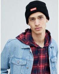 Globe - Knitted Beanie With Logo Patch In Black - Lyst
