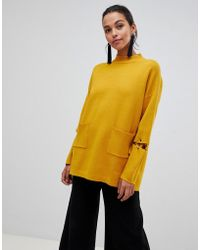 Liquorish - Long Sweater With Front Pockets And Lacing Detail On Sleeves - Lyst