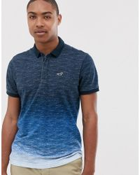 Hollister Icon Logo Washed Out Polo In Navy Marl Dip Dye
