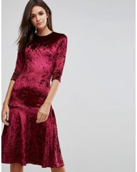 Club L - Crushed Velvet Peplum Hem Midi Dress - Lyst
