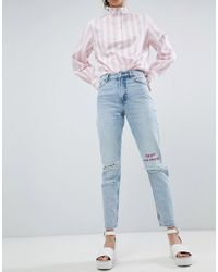 Monki - Kimomo Ripped Knee With Words Jeans - Lyst