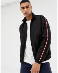 Bershka - Windbreaker In Black With Red Side Stripe - Lyst
