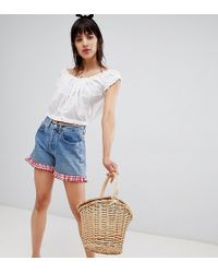 Reclaimed (vintage) - Revived Levi's Shorts With Gingham Frill - Lyst