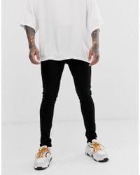 Criminal Damage Skinny Jeans In Black