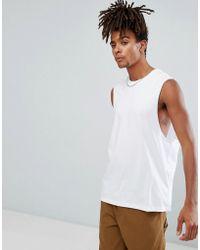 9de25cd40654d ASOS Super Longline Sleeveless T-shirt With Contrast Raw Edge Hem in ...