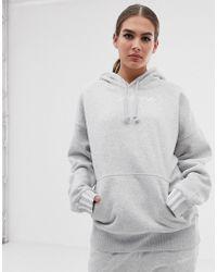 c77b49d8d6 Sweats à capuche adidas Originals femme à partir de 40 € - Lyst