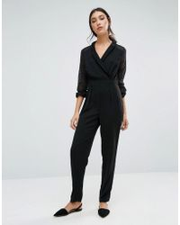 Girls On Film - Jumpsuit With Lace Sleeves - Lyst