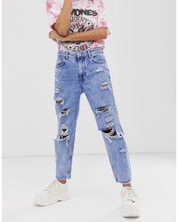 Bershka - Blaue Mom-Jeans mit starken Rissen - Lyst