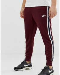 official photos 1f902 ff17e Nike - Tribute Joggers In Red - Lyst