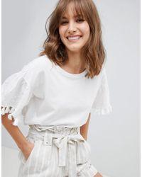Mango - Pom Pom Embroidered Sleeve T-shirt In Cream - Lyst