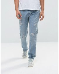 Hollister - Jeans Slim Fit Destroyed Light Wash - Lyst