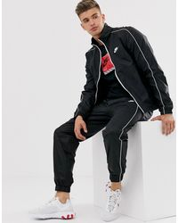 Nike Chándal de punto en negro